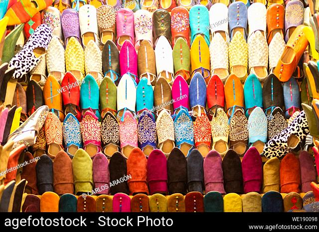 Showy stalls selling artisan shoes in the historic Souk of Marrrakech