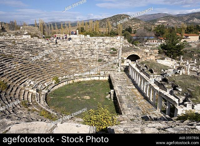 The Amphitheater of Aphrodisias. The lower part of the auditorium is intact, with nine rows of marble seats divided into five wedges of radial stairs