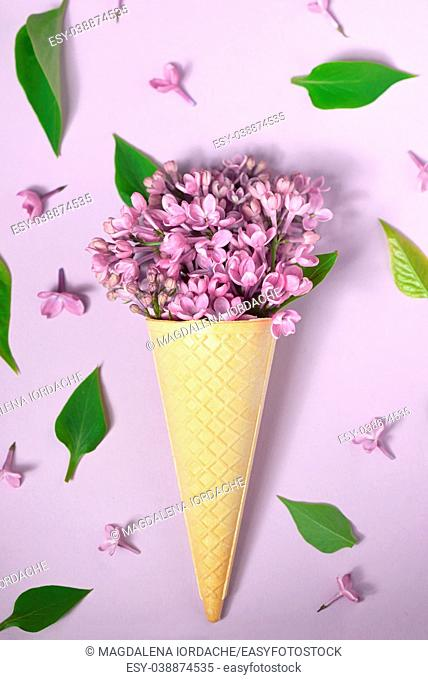 Ice cream cone with purple lilac on paper