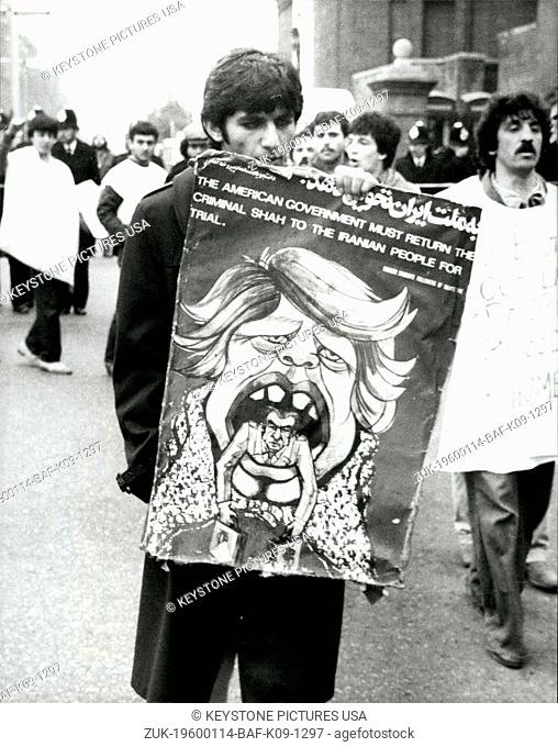 1980 - 1st May 1980 Iranian Embassy Siege A demonstrator in Kensington Gore, London, near the Iranian Embassy, carrying a poster caricaturing President Carter...