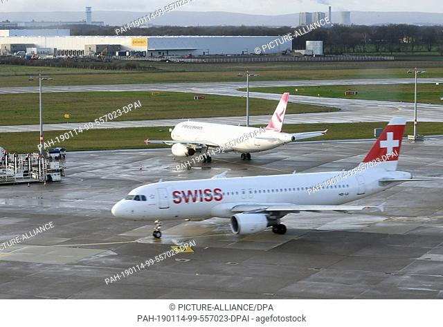 14 January 2019, Lower Saxony, Hannover: An Airbus A320-214 of Swiss International Air Lines is taxiing to the take-off position on the southern runway of the...