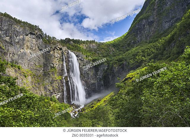 waterfall Feigumfossen spotlighted by the sun, Norway, site at the Lustrafjorden, Sognefjorden