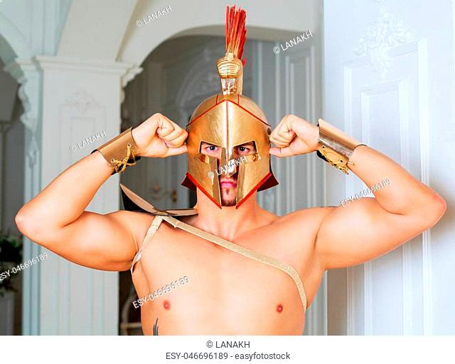 handsome dancer dressed as a gladiator, in the studio