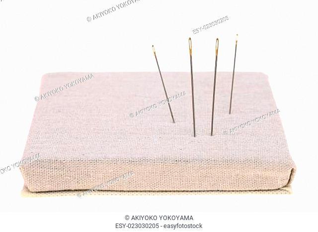 sewing needle and burlap pin-cushion