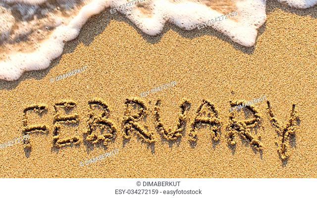 Inscription FEBRUARY on a gentle beach sand with the soft wave (months of the year series)