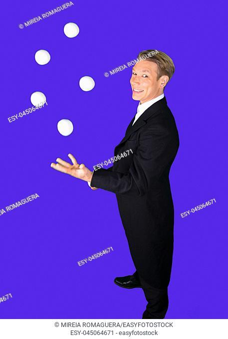 Juggler smiling with white juggling balls