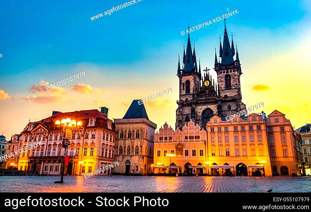 Tynsky Temple on illuminated Old Town square in Prague at sunrise