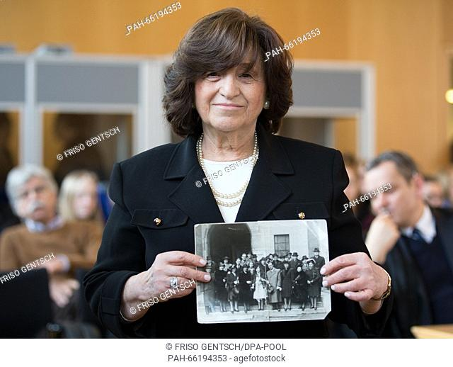 Auschwitz survivor Angela Orosz holds up a wedding picture of her parents as she stands in the courtroom during trial against former Auschwitz SS-guard Reinhold...