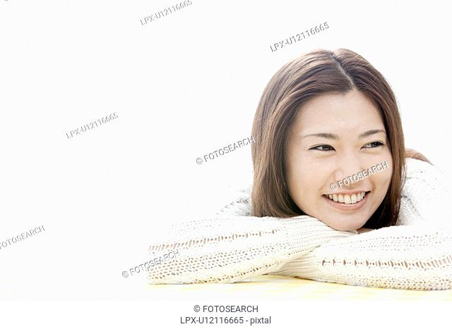 Young woman with head in hands, Tokyo Prefecture, Honshu, Japan