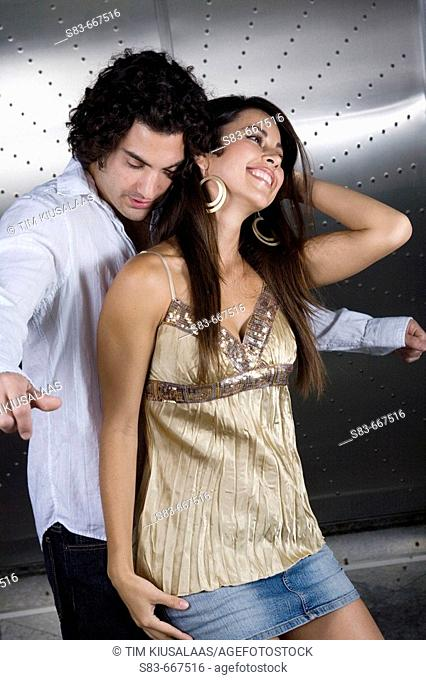 young couple dancing at club