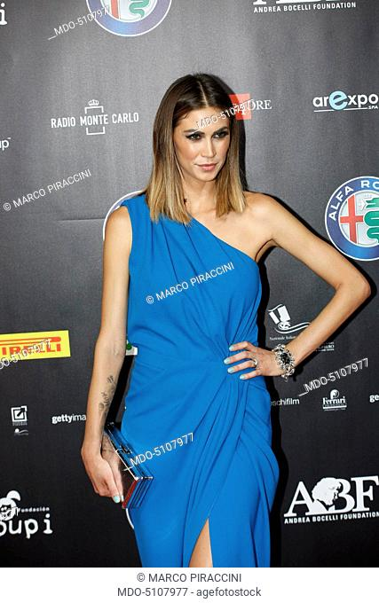 Italian showgirl Melissa Satta posing on the red carpet of the charity concert Bocelli and Zanetti Night at the Open Air Theater of Expo in Milano