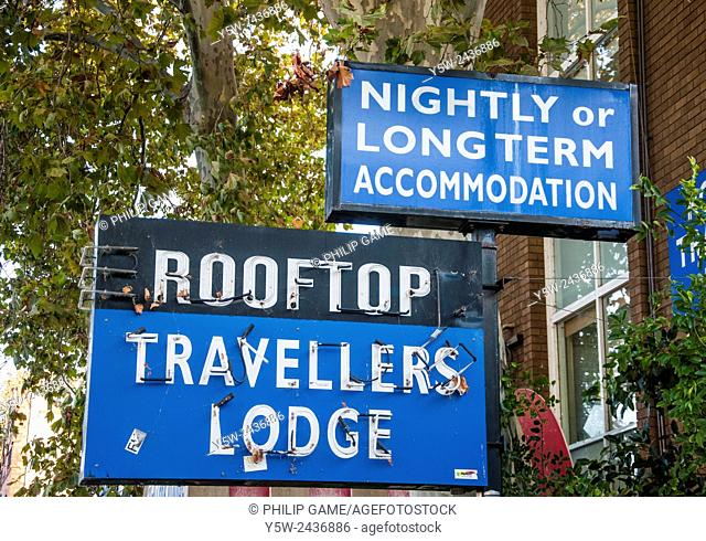 Signs advertising accommodation for budget travellers in Glebe, Sydney, Australia