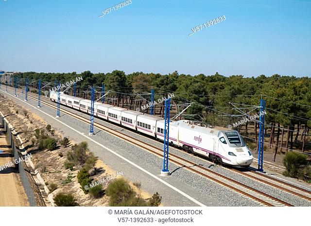 AVE High-speed train Madrid-Valladolid traveling along the Meseta. Coca, Segovia province, Castilla León, Spain
