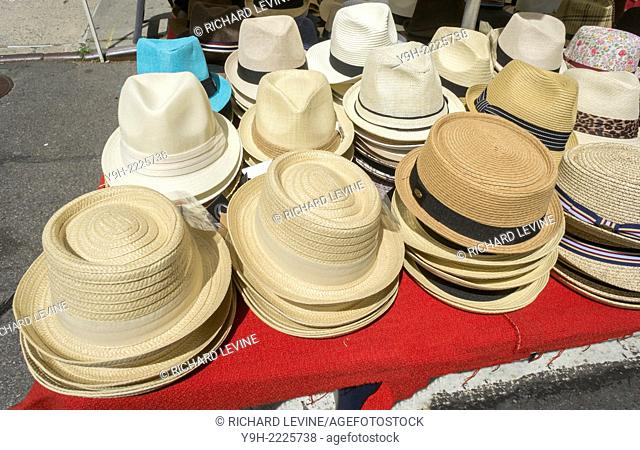 Hats for sale at a kiosk in a street fair in the Greenwich Village neighborhood of New York