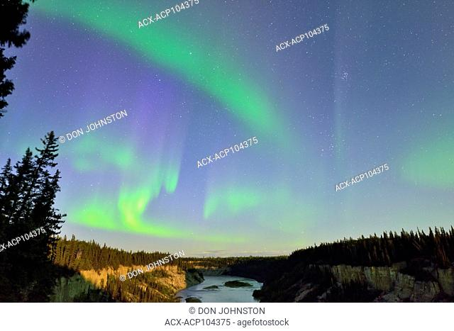 Aurora borealis (Northern Lights) over Louise Falls gorge, Twin Falls Territorial Park, Northwest Territories, Canada