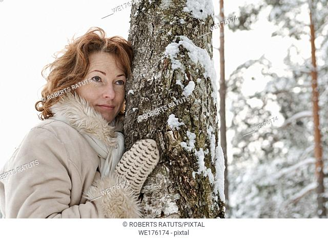 Portrait of thoughtful red-haired woman in winters day.Latvia