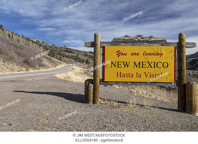 Chama, New Mexico - A bilingual sign on Highway 17 near Cumbres Pass in the San Juan Mountains tells travelers they are leaving New Mexico