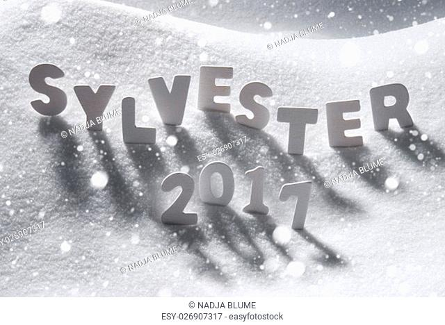 White Letters Building German Text Sylvester 2017 Means New Years Eve 2017 In Snow. Snowy Scenery With Snowflakes For Happy New Year Greetings