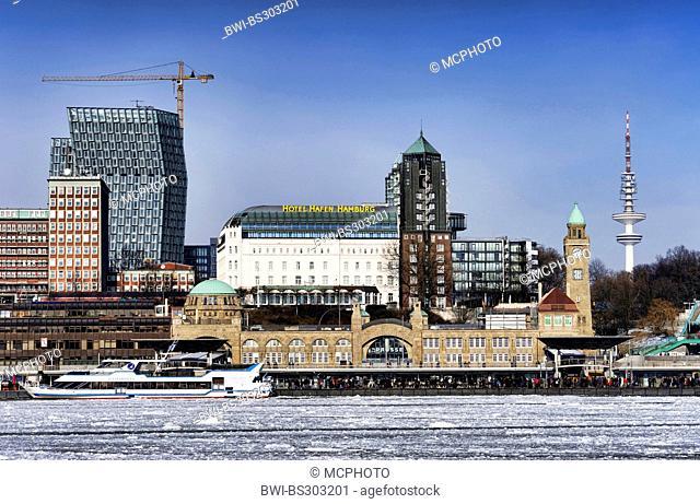 winterly Port of Hamburg, with Hotel Hafen Hamburg, St. Pauli Landungsbruecken, Tanzende Tuerme and television tower, Germany, Hamburg