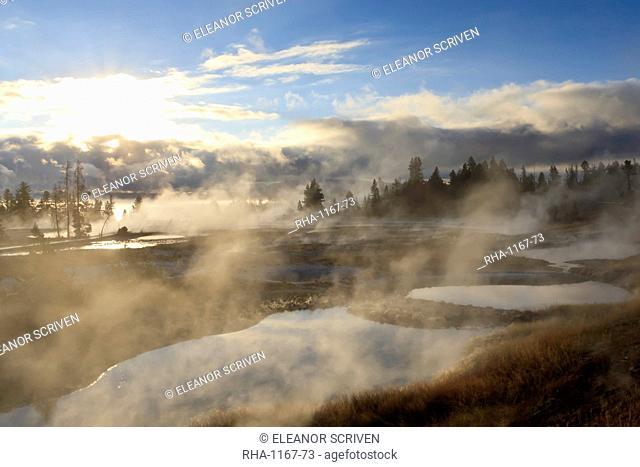 Freezing mists, dawn, West Thumb Geyser Basin, Yellowstone National Park, UNESCO World Heritage Site, Wyoming, United States of America, North America