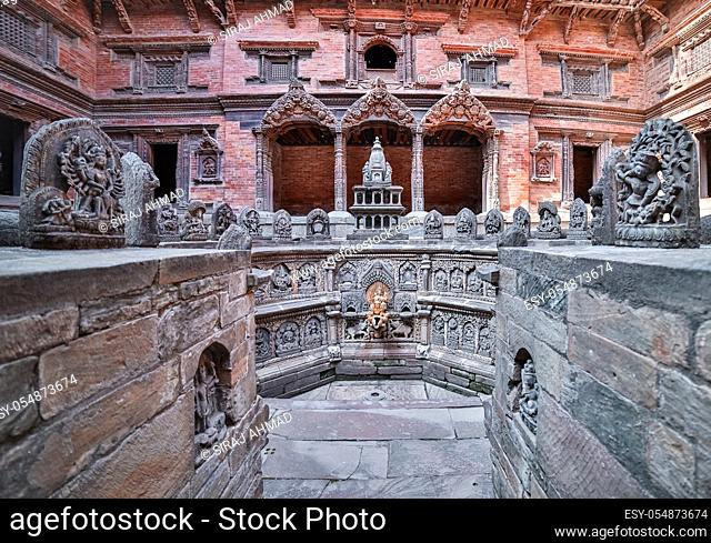 Ancient Tap decorated with sculptures of Hindu Gods and Goddesses at Patan Durbar Square