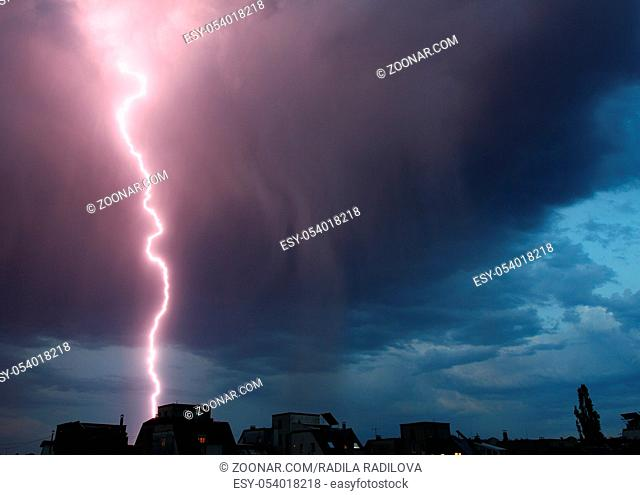 Thunderstorm lights. Bright lightning thunderstorms sparkle from the cloud. Dangerous electrical flash. Levin or scintillation for weather concept