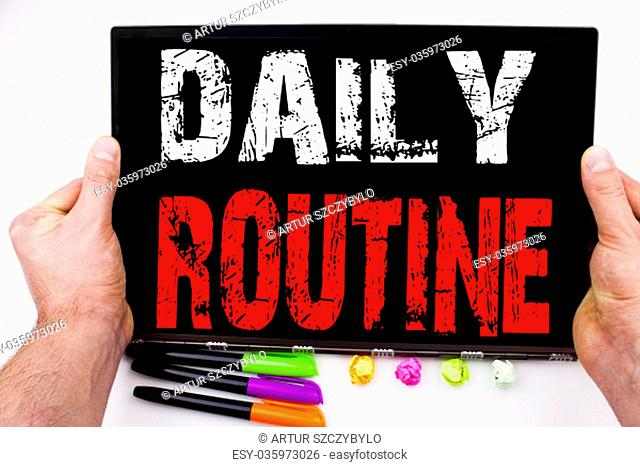 Daily Routine text written on tablet, computer in the office with marker, pen, stationery. Business concept for Accuracy Procedure white background with space