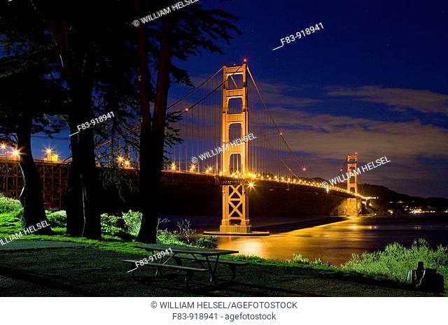 USA, California, San Francisco, Golden Gate Bridge, Monterey cypress Cupressus macrocarpa trees, looking north toward Marin County, dusk, NR