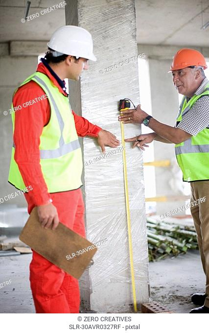 Architect talking to building worker