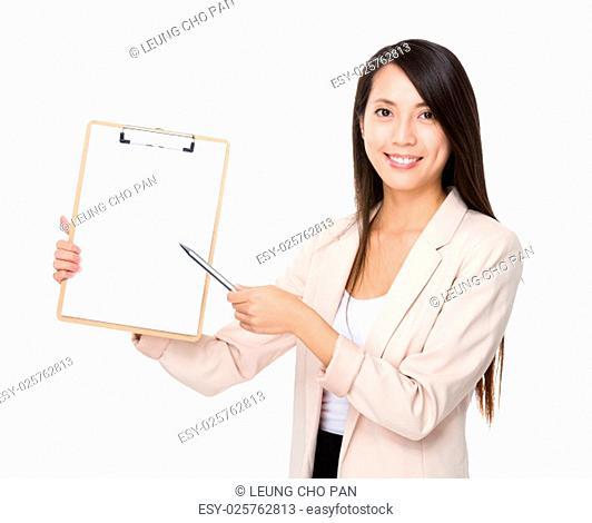 Businesswoman pen point to clipboard