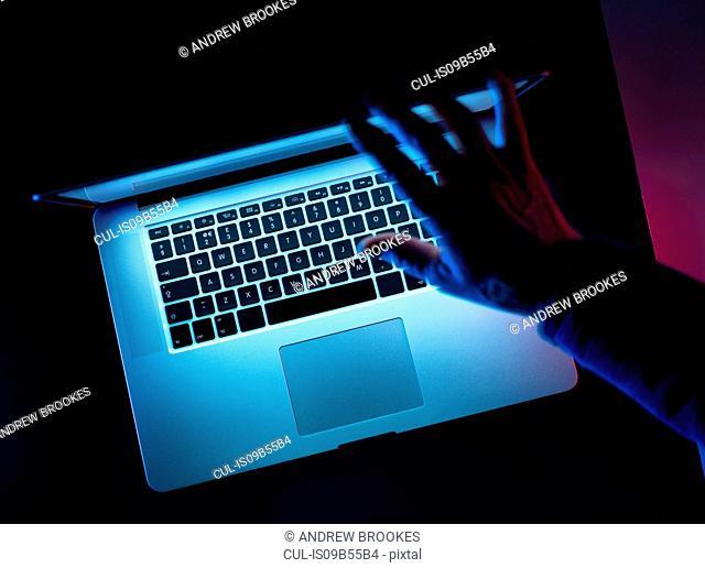 Hacking, man opening laptop computer
