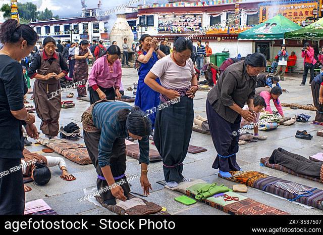 Tibetan buddhist devotees praying around Jokhang temple, Lhasa Tibet. Barkhor square in the heart of Lhasa old town in Tibet