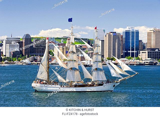Tall Ship Europa from The Netherlands cruises by Halifax skyline in Parade of Sail, Tall Ships Nova Scotia festival, Halifax, Nova Scotia