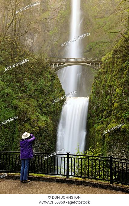 Multnomah Falls- Tourist taking pictures from the bridge