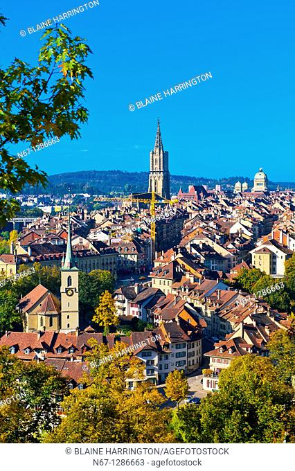 Cityscape of the medieval city center of Bern with the Munster Cathedral and Federal Palace (Swiss Parliament building) in background