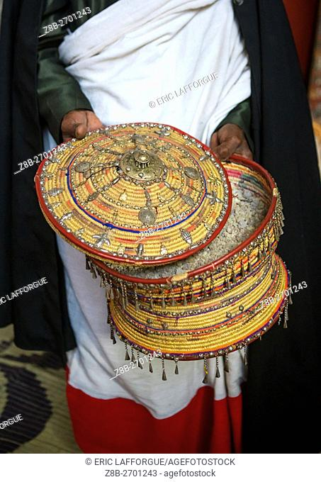 Ethiopia, Amhara Region, Lalibela, ethiopian orthodox priest with an insence basket in nakuto lab rock church