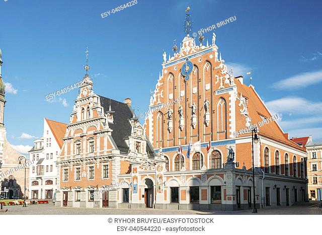 Riga, Latvia. Schwabe House At Town Hall Square, Ancient Historical Landmark And Popular Touristic Showplace In Summer Sunny Day Under Blue Sky