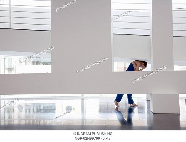 girl squeezed in modern architecture photo