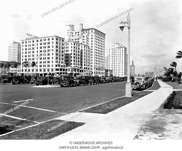 Miami, Florida: 1925 Looking north on Biscayne Bouleveard at Flagler Street in Miami with the McAllister Hotel at left front and Bayfront Park to the right