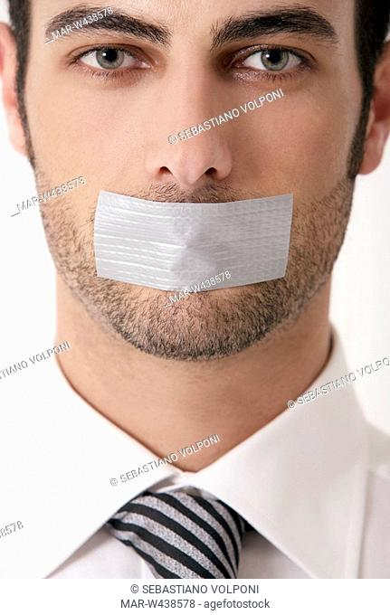 man with his mouth tabed closed