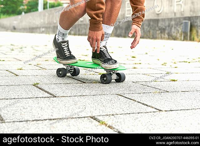 Close-up of Skateboarder doing a trick at the park. Concept of leisure activity, sport, extreme, hobby and motion