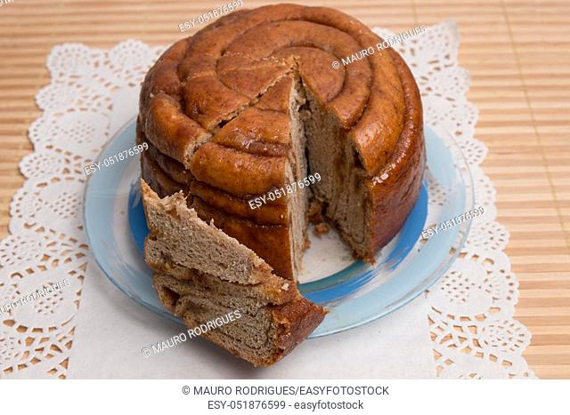 Famous Portuguese folar cake presented in the table