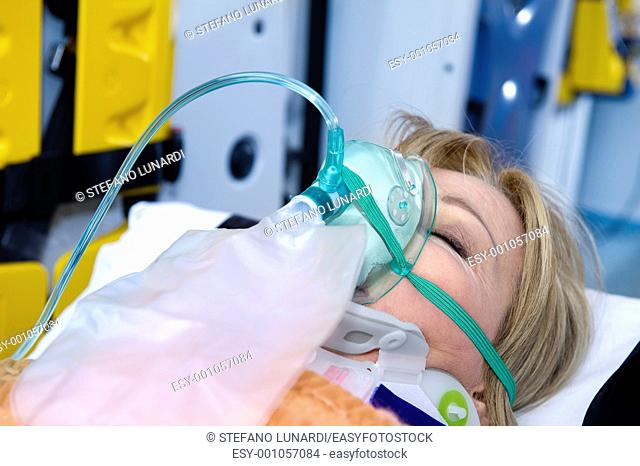 Unconscious Woman With Oxygen Mask, ambulance interior