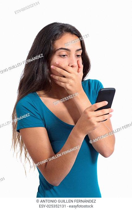 Worried teenager girl looking at smart phone isolated on a white background