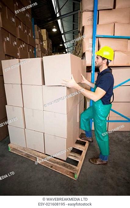 Warehouse worker loading up a pallet