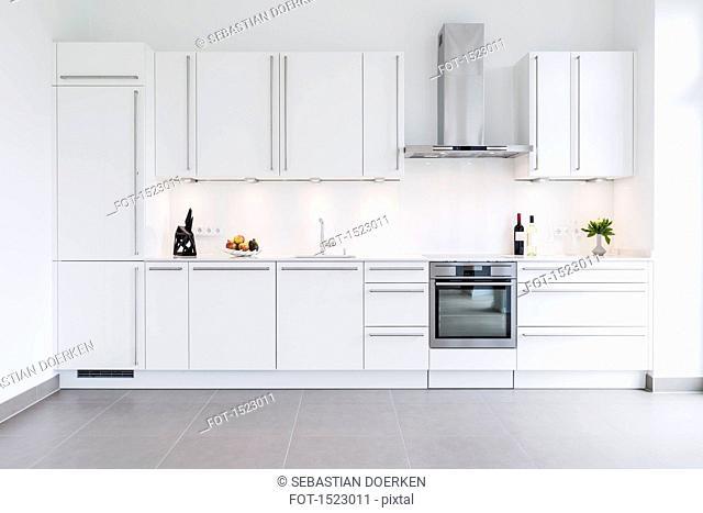 Modern kitchen design with white cabinets