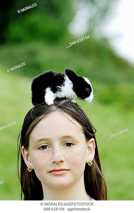 Girl with baby rabbit