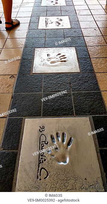 Autographs and hand prints of actors on a metal tile near Film Festival Palace in Cannes, France