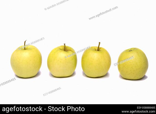Close view of a bunch of yellow ginger gold variety type apples isolated on a white background