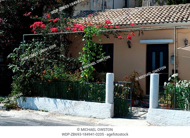 house on coastal road Benitses Corfu Greece